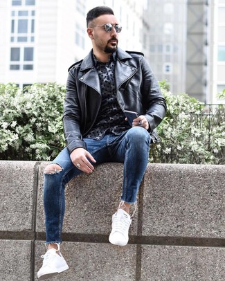 How to wear: white low top sneakers, blue ripped skinny jeans, navy print long sleeve shirt, black leather biker jacket