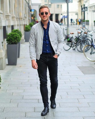 How to wear: black leather chelsea boots, black skinny jeans, navy long sleeve shirt, grey bomber jacket