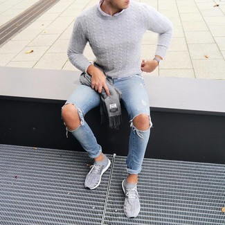 How to wear: grey athletic shoes, light blue ripped skinny jeans, white long sleeve shirt, grey cable sweater
