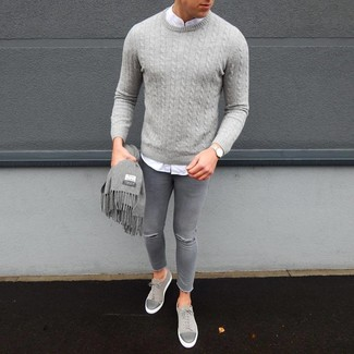 How to wear: grey suede low top sneakers, grey ripped skinny jeans, white long sleeve shirt, grey cable sweater