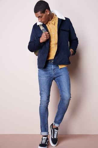 How to wear: black canvas low top sneakers, blue skinny jeans, yellow long sleeve shirt, navy suede field jacket