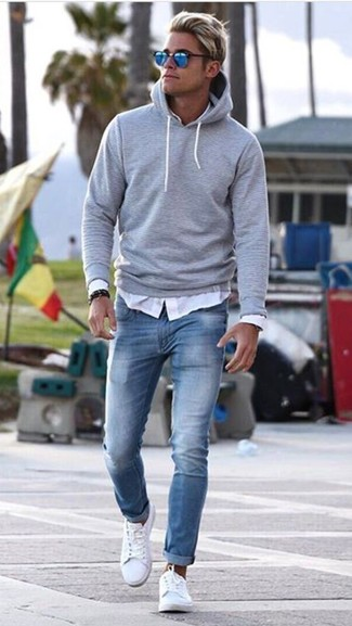 How to wear: white leather low top sneakers, light blue skinny jeans, white long sleeve shirt, grey hoodie
