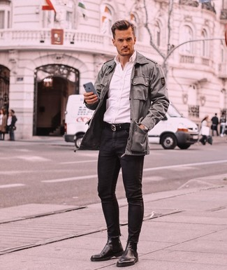 How to wear: black leather chelsea boots, black skinny jeans, white long sleeve shirt, olive military jacket