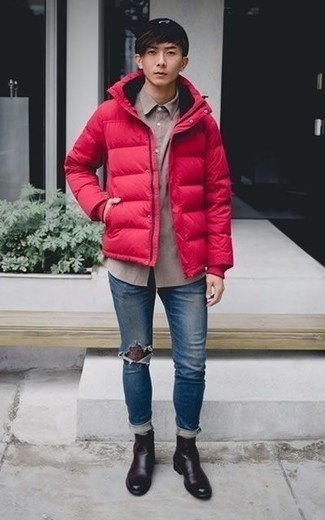 How to Wear Blue Ripped Skinny Jeans For Men: This pairing of a red puffer jacket and blue ripped skinny jeans combines comfort and functionality and helps you keep it low profile yet modern. To give your overall ensemble a sleeker feel, add a pair of dark purple leather chelsea boots to the equation.