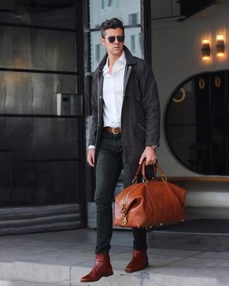 How to wear: burgundy leather chelsea boots, black skinny jeans, white long sleeve shirt, black raincoat