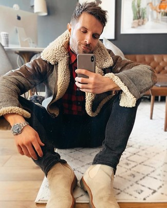 How to wear: beige suede chelsea boots, black skinny jeans, red and black check flannel long sleeve shirt, brown shearling jacket