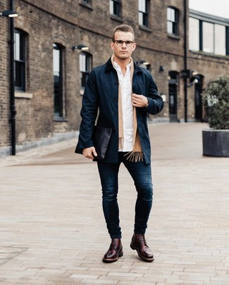 How to wear: burgundy leather brogues, navy skinny jeans, white long sleeve shirt, navy trenchcoat