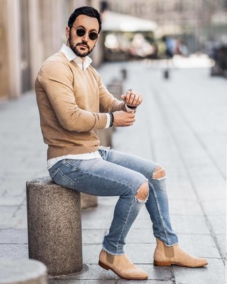 How to wear: tan suede chelsea boots, light blue ripped skinny jeans, white long sleeve shirt, tan v-neck sweater