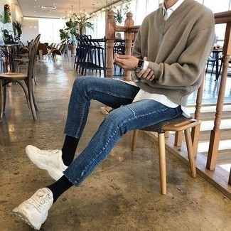 How to Wear White Athletic Shoes For Men: Consider pairing a brown v-neck sweater with blue skinny jeans to create an interesting and modern-looking casual outfit. Punch up your ensemble with white athletic shoes.