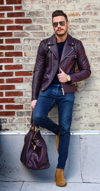 How to wear: tobacco suede chelsea boots, navy skinny jeans, black long sleeve t-shirt, burgundy leather biker jacket