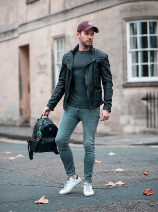 How to wear: white leather low top sneakers, grey skinny jeans, charcoal long sleeve t-shirt, black leather biker jacket