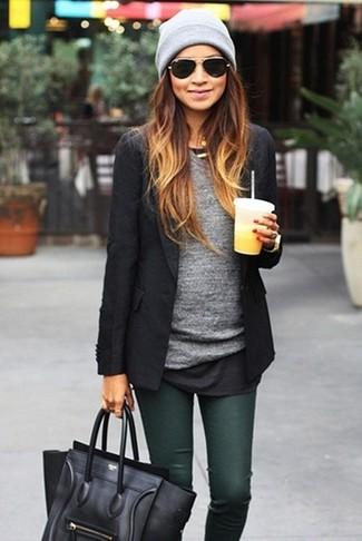 How to wear: black leather satchel bag, dark green skinny jeans, grey long sleeve t-shirt, black blazer