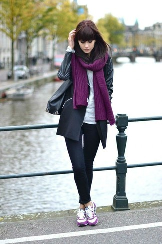 How to wear: hot pink suede low top sneakers, black skinny jeans, white long sleeve t-shirt, black coat