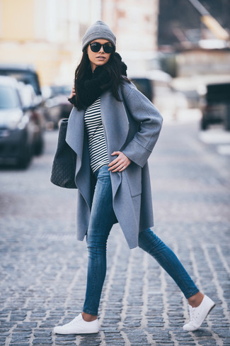 How to wear: white low top sneakers, blue skinny jeans, black and white horizontal striped long sleeve t-shirt, grey coat