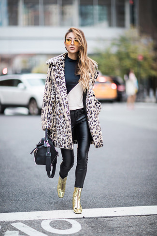 How to wear: gold leather ankle boots, black leather skinny jeans, white and black long sleeve t-shirt, beige leopard fur coat