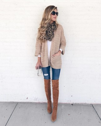 How to wear: tobacco suede over the knee boots, blue ripped skinny jeans, white long sleeve t-shirt, tan knit open cardigan