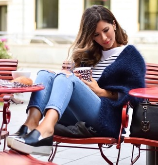 How to Wear Light Blue Ripped Skinny Jeans: A navy fluffy open cardigan and light blue ripped skinny jeans are amazing essentials that will integrate really well within your current outfit choices. A pair of black leather slip-on sneakers looks incredible here.