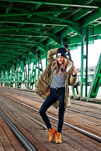 How to wear: tan suede lace-up ankle boots, navy skinny jeans, white and navy horizontal striped long sleeve t-shirt, olive parka