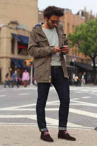 How to wear: dark brown suede desert boots, navy skinny jeans, white and black horizontal striped long sleeve t-shirt, brown parka
