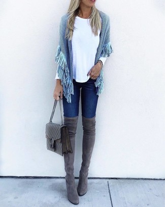 How to wear: charcoal suede over the knee boots, navy skinny jeans, white long sleeve t-shirt, light blue knit poncho