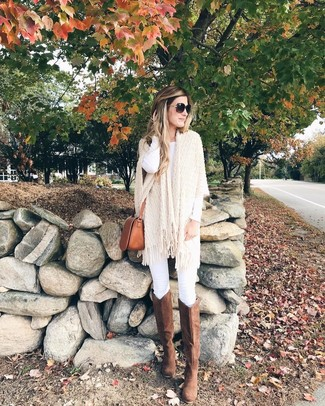 How to Wear Brown Suede Knee High Boots: For a foolproof off-duty option, you can rely on this combo of a beige knit poncho and white skinny jeans. Not sure how to finish off? Complete your outfit with brown suede knee high boots to ramp up the wow factor.