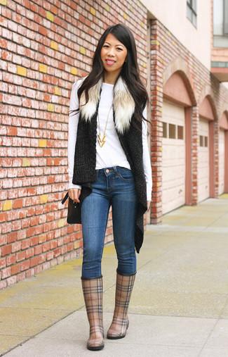 How to wear: brown plaid rain boots, blue skinny jeans, white long sleeve t-shirt, black knit fur vest
