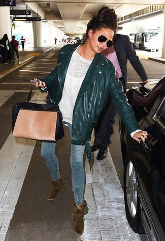 How to wear: olive suede ankle boots, light blue skinny jeans, white oversized sweater, dark green leather biker jacket