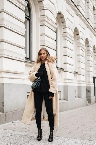 How to wear: black embellished suede ankle boots, black skinny jeans, black knit oversized sweater, beige fleece coat