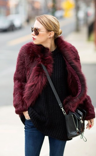 How to wear: black leather crossbody bag, navy skinny jeans, black knit oversized sweater, burgundy fur coat