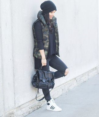 How to wear: white leather high top sneakers, charcoal ripped skinny jeans, black oversized sweater, dark green camouflage gilet