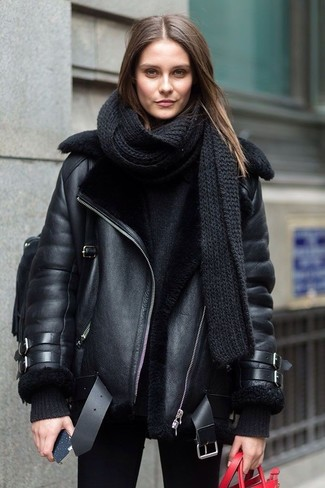 How to wear: black leather backpack, black skinny jeans, black oversized sweater, black shearling jacket