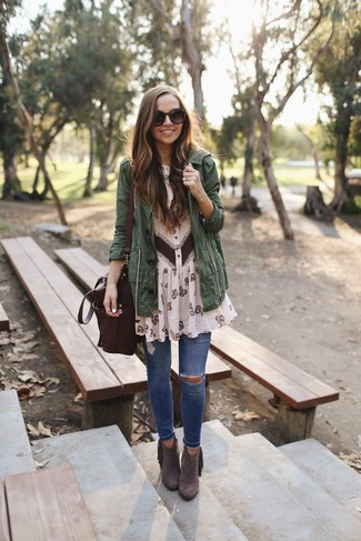 How to wear: dark brown suede ankle boots, blue ripped skinny jeans, beige floral chiffon shirtdress, dark green anorak