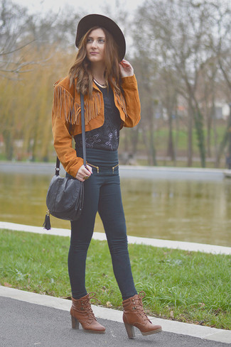 How to wear: brown leather lace-up ankle boots, black skinny jeans, black lace short sleeve blouse, tobacco suede biker jacket