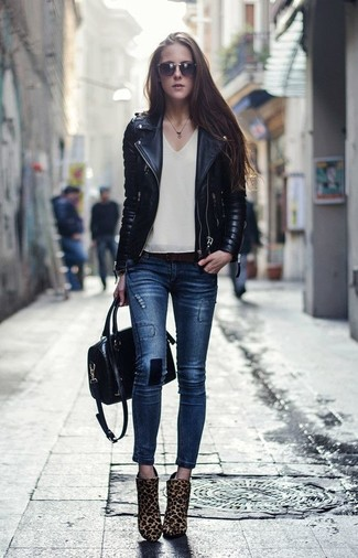 How to wear: tan leopard calf hair ankle boots, navy skinny jeans, beige sleeveless top, black quilted leather biker jacket