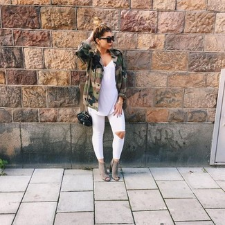 How to wear: grey cutout suede ankle boots, white ripped skinny jeans, white sleeveless top, olive camouflage military jacket