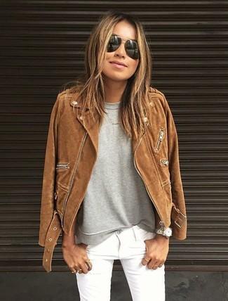 How to wear: black sunglasses, white skinny jeans, grey sweatshirt, brown suede biker jacket