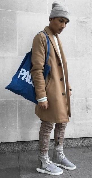 How to wear: grey canvas high top sneakers, khaki skinny jeans, white sweatshirt, camel overcoat