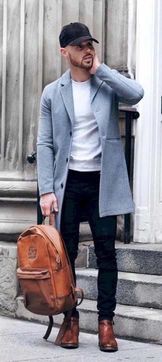 How to wear: brown leather chelsea boots, black skinny jeans, white sweatshirt, light blue overcoat
