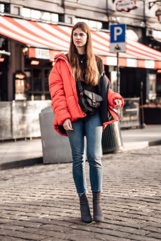 How to wear: dark brown suede ankle boots, blue skinny jeans, black sweatshirt, red puffer jacket