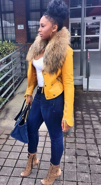 How to wear: tan cutout leather ankle boots, navy skinny jeans, white tank, yellow leather biker jacket