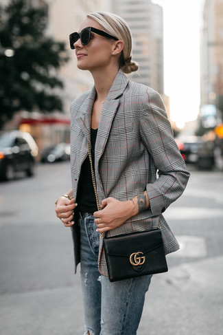 How to wear: black leather crossbody bag, blue ripped skinny jeans, black tank, grey plaid blazer