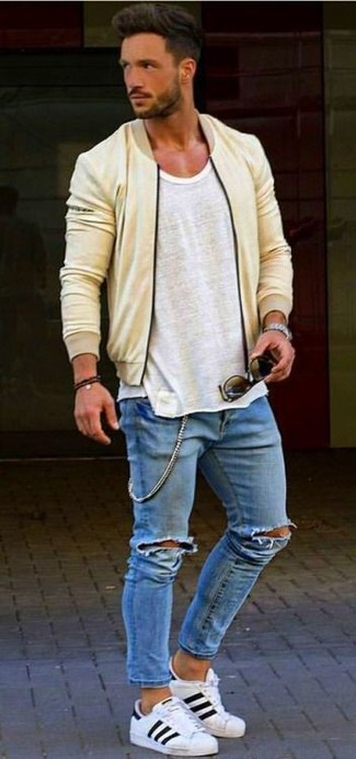 How to wear: white leather low top sneakers, blue ripped skinny jeans, grey tank, yellow bomber jacket