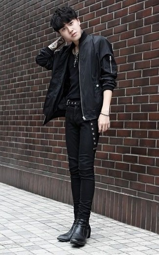 How to Wear a Black Bomber Jacket For Men: For a look that's very simple but can be manipulated in a great deal of different ways, choose a black bomber jacket and black skinny jeans. And if you want to effortlessly smarten up your look with a pair of shoes, why not add black leather chelsea boots to the mix?