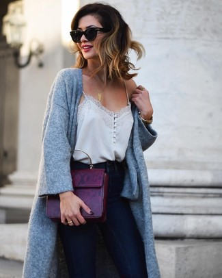 How to wear: dark purple leather satchel bag, navy skinny jeans, grey silk tank, grey knit coat