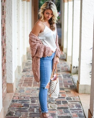 How to wear: beige suede heeled sandals, blue ripped skinny jeans, white satin tank, pink knit open cardigan