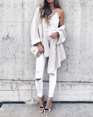 How to wear: white leather heeled sandals, white ripped skinny jeans, white lace tank, beige knit open cardigan
