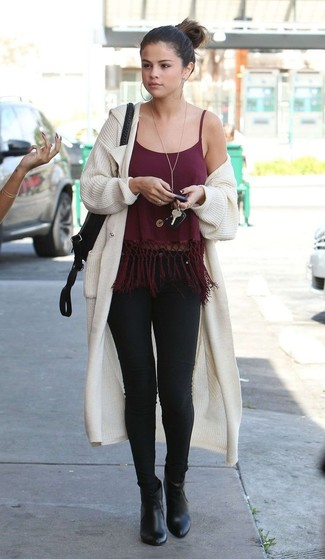 How to wear: black leather ankle boots, black skinny jeans, burgundy fringe tank, beige knit open cardigan