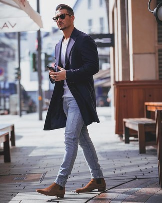 How to Wear Dark Brown Suede Chelsea Boots For Men: This off-duty combo of a navy overcoat and light blue skinny jeans comes in handy when you need to look dapper in a flash. Dark brown suede chelsea boots will give an extra dose of refinement to an otherwise standard ensemble.