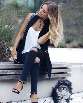 How to wear: black leather heeled sandals, charcoal ripped skinny jeans, white silk tank, black vest