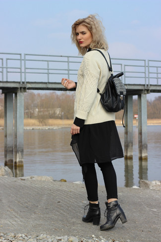 How to wear: black leather lace-up ankle boots, black skinny jeans, black chiffon tunic, beige cable sweater